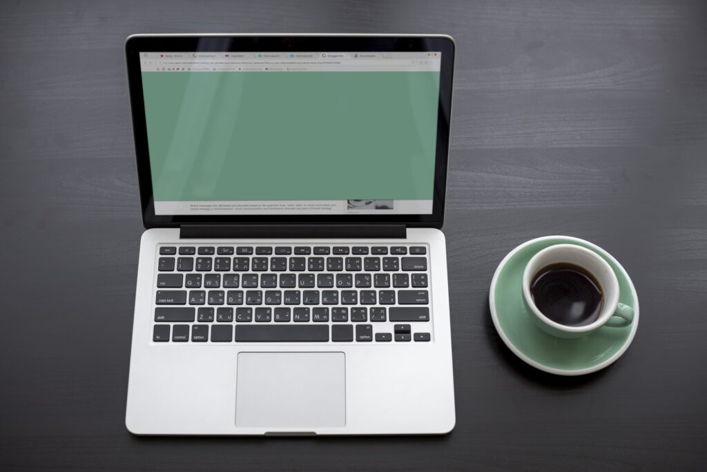 Laptop Showing Green Screen Desktop
